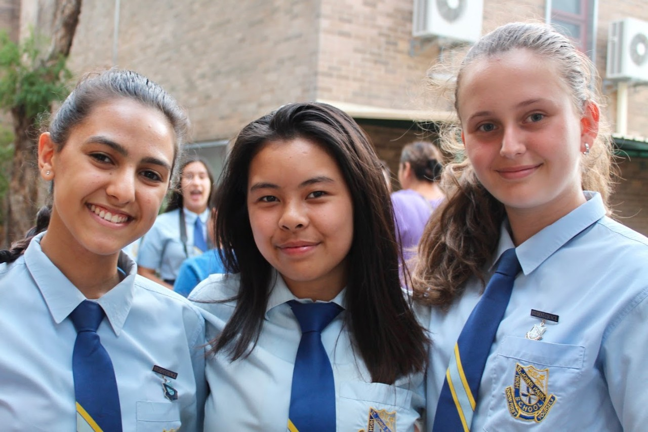 Students smiling on open night