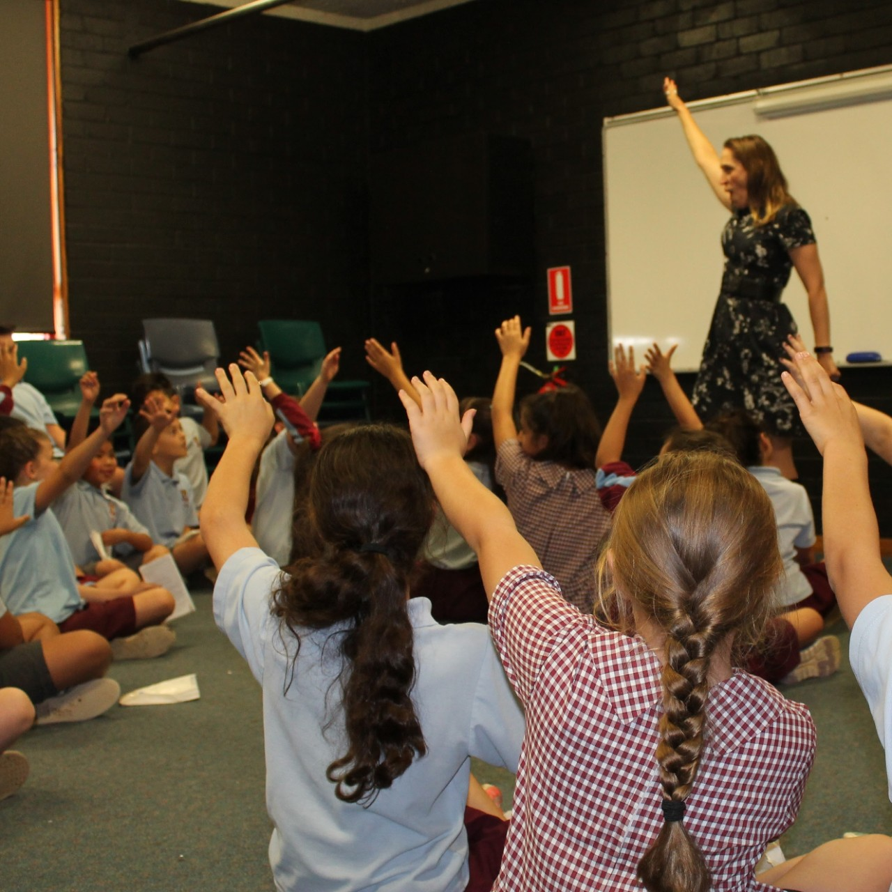 Students participate in a drama lesson