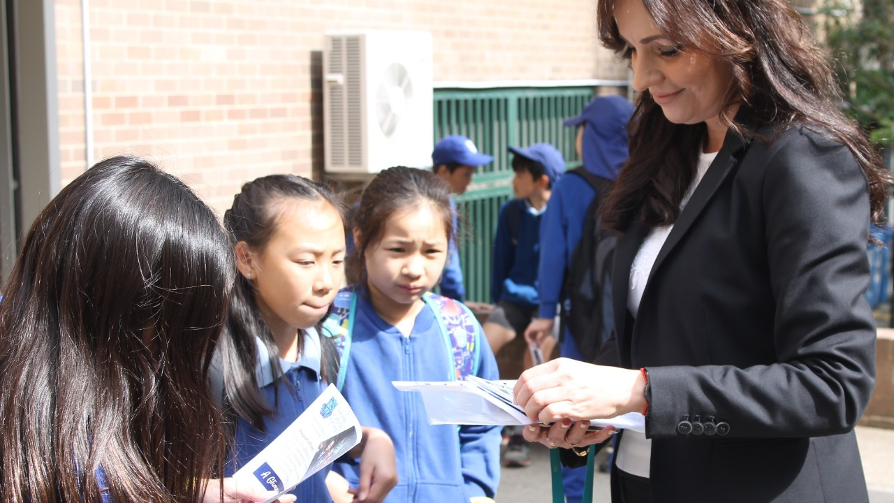 Primary links coordinator showing students around the school