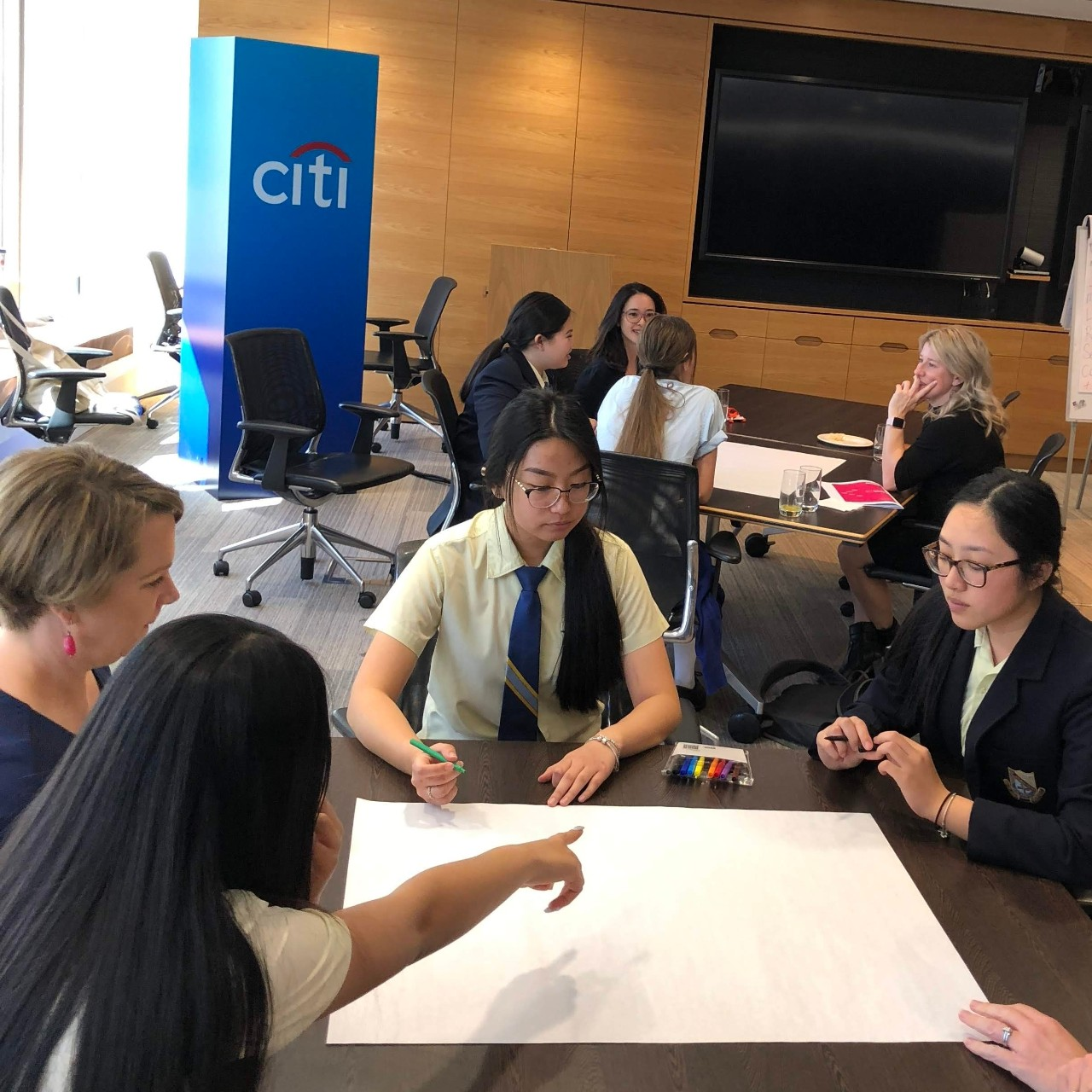 Students in groups at Citi bank