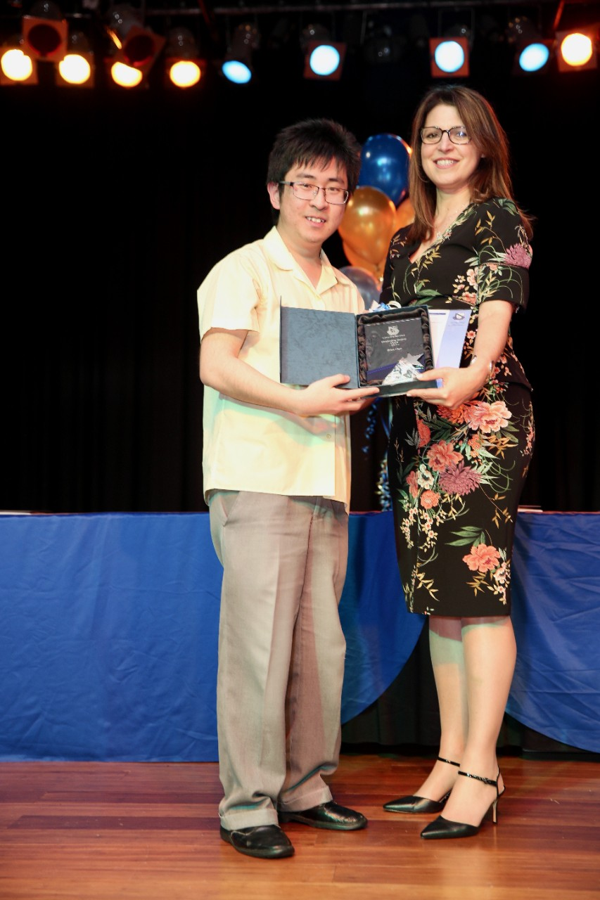 Mr Brian Chau receiving awards at graduation