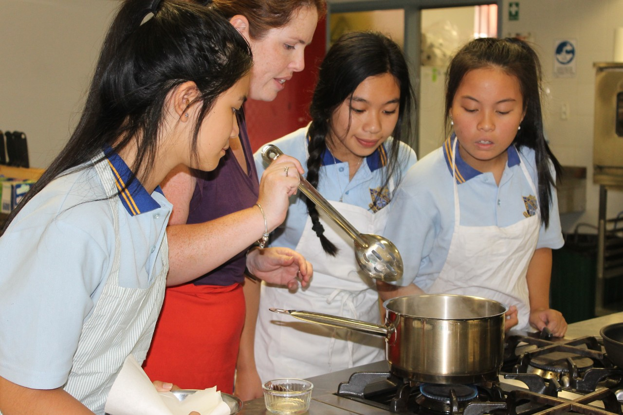 Teacher and students cooking together