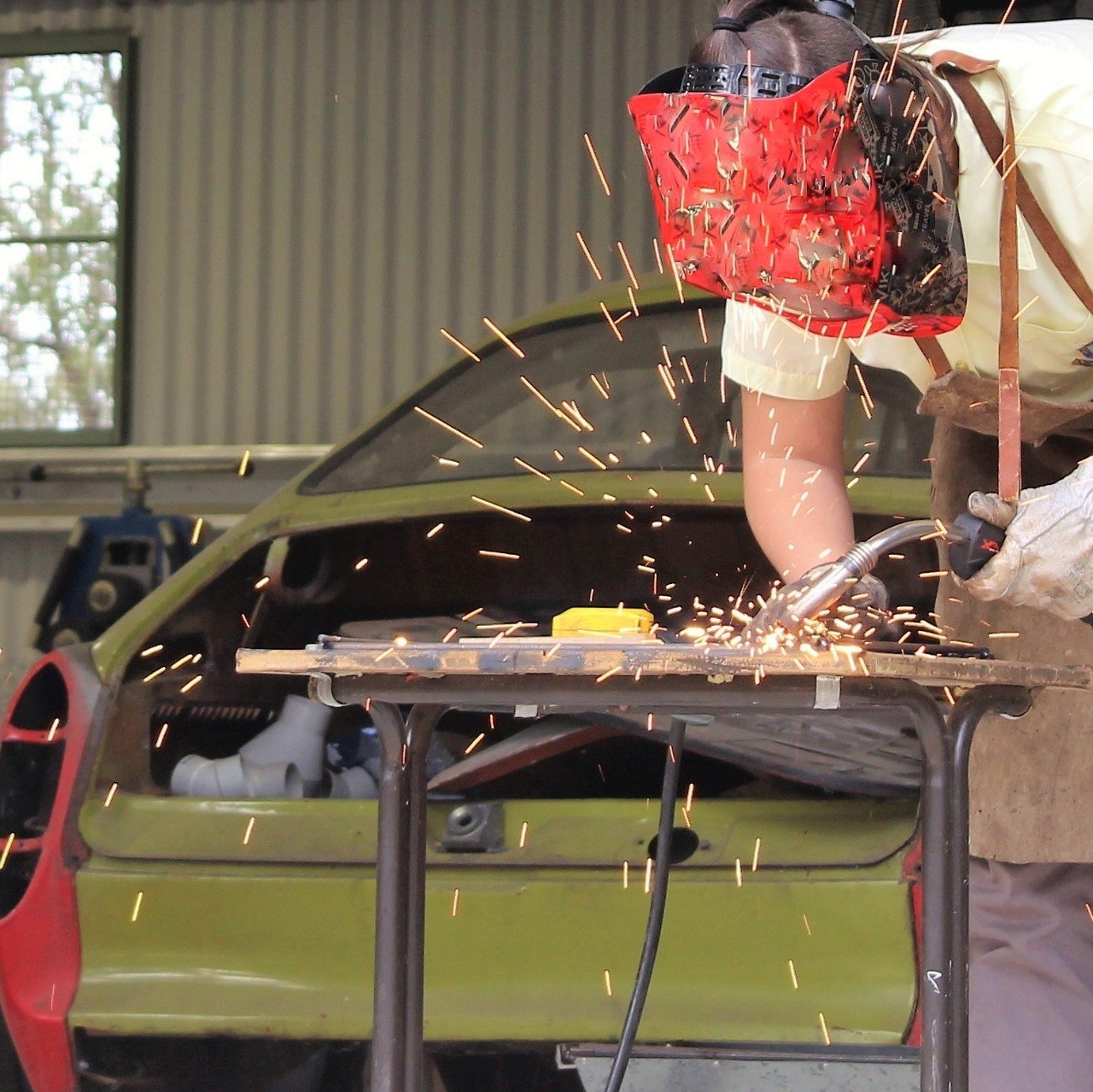 Student welding in metals and engineering