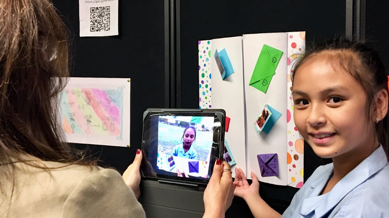 Student holding iPad to show the use augmented reality