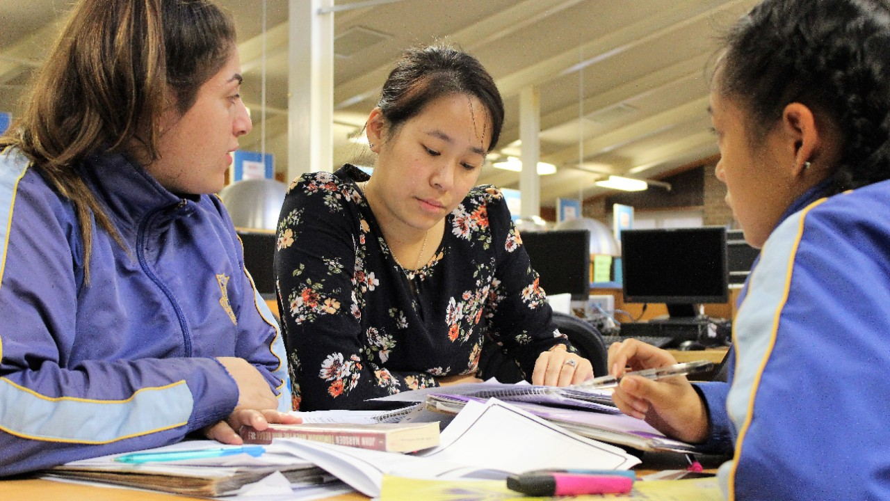 Teacher helping student in Study Hub