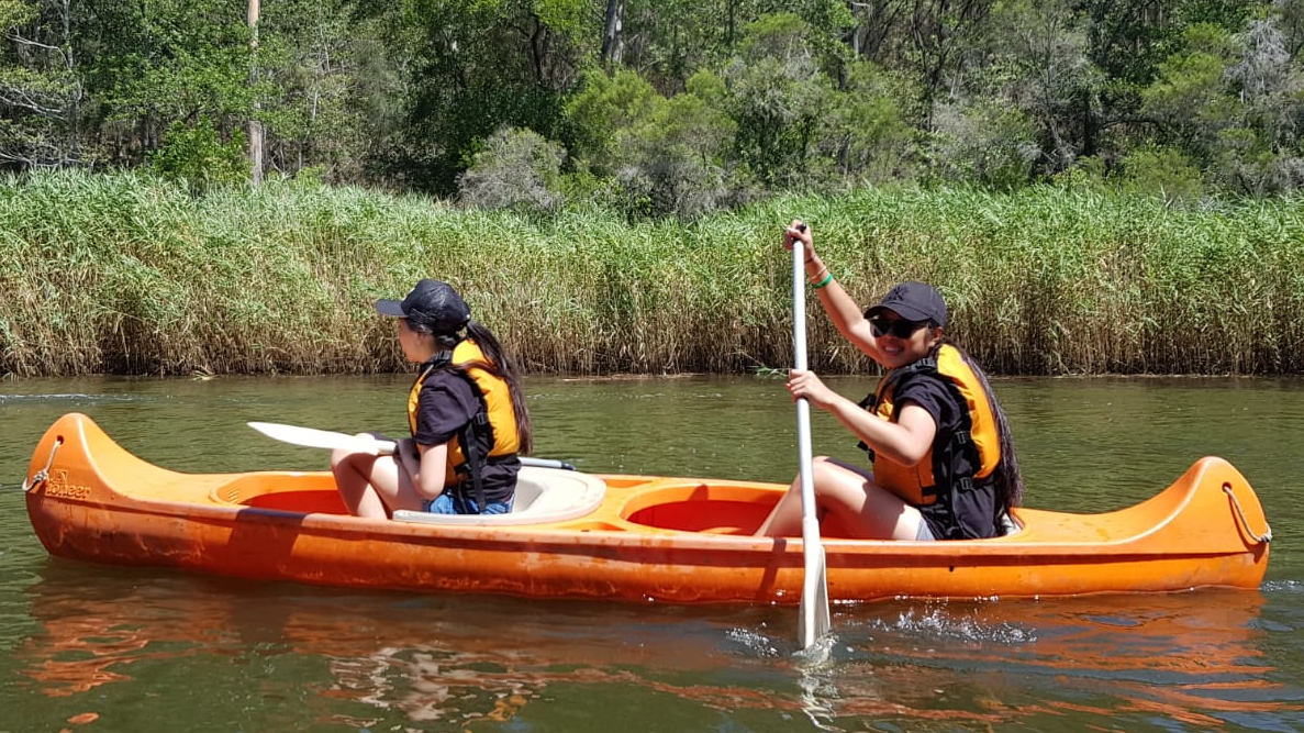 Students canoeing in lake